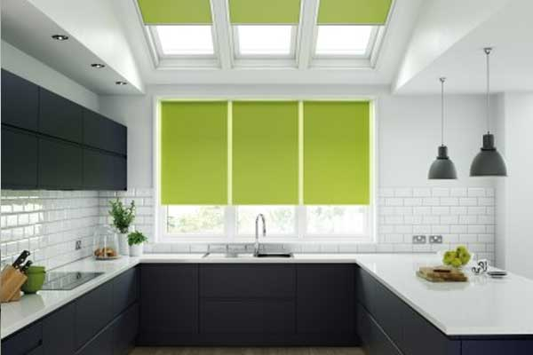 green roller blinds in black and white kitchen