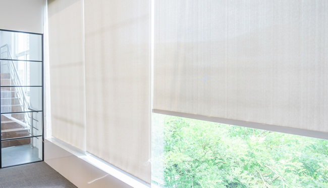 half drawn blinds next to a window