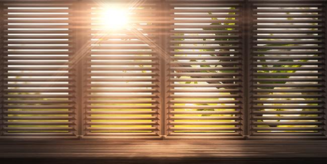 sunlight shining through horizontal blinds