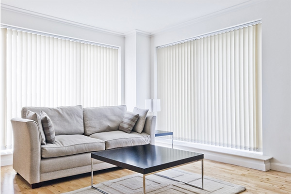 vertical blinds in a white living room