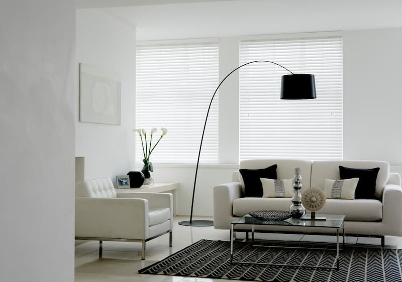 gloss white living room with horizontal blinds