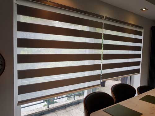 very large horizontal blinds next to a kitchen area